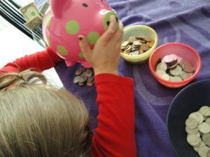 Sorting, Counting, Stacking and Rolling Coins…a lesson in MONEY